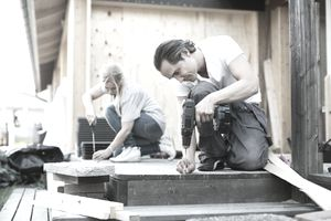 Couple working outside house during home improvement.