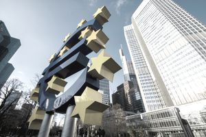 Euro sign sculpture in front of European Central Bank building in Frankfurt