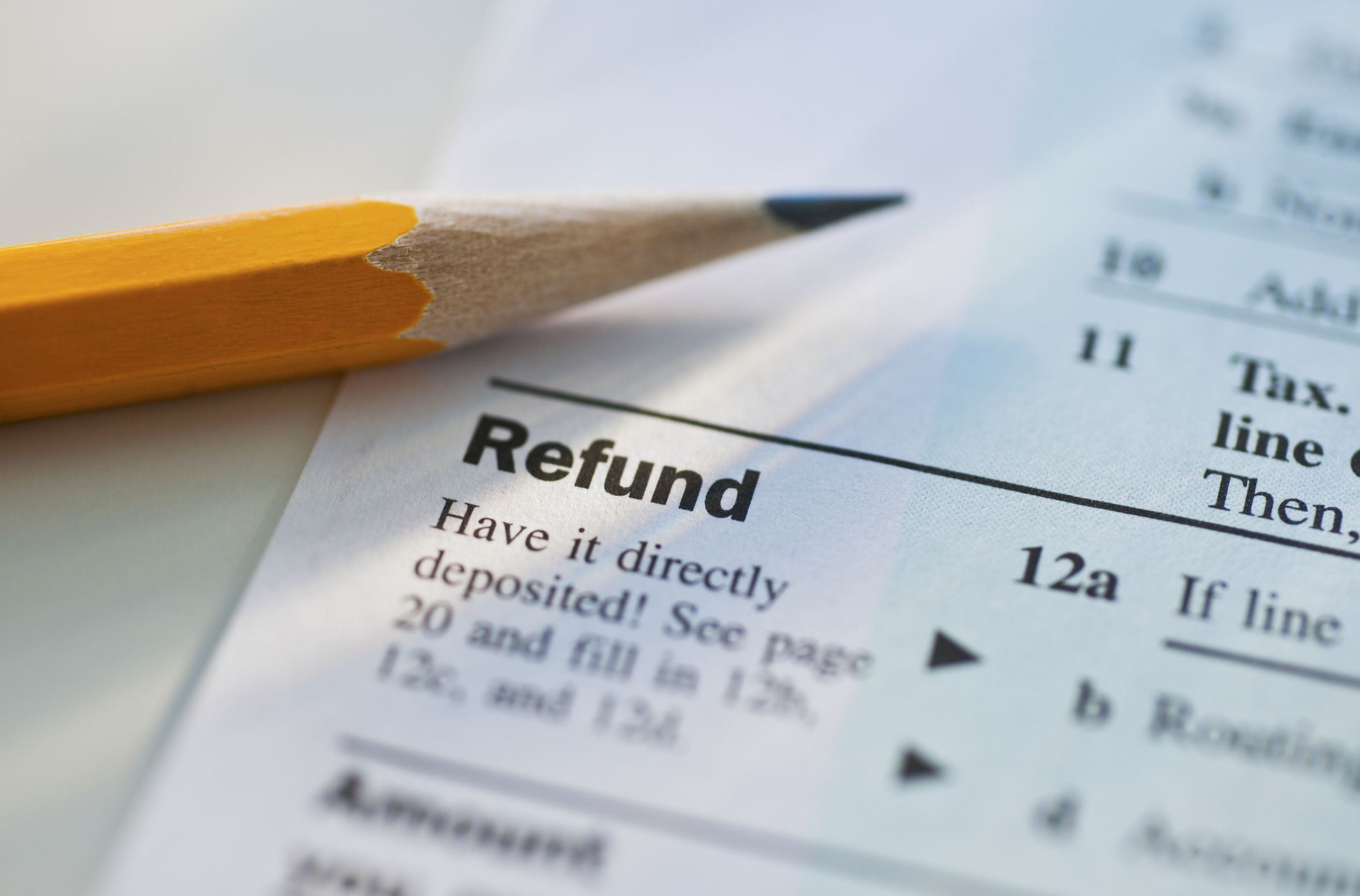 Close up of a tax form refund line with a sharpened pencil