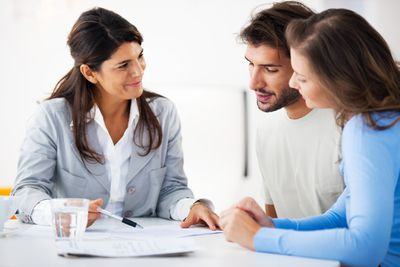 Home sellers preparing transfer disclosure statement with realtor