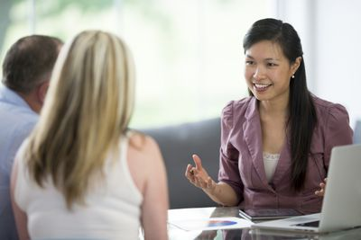 Couple discussing finances with an advisor