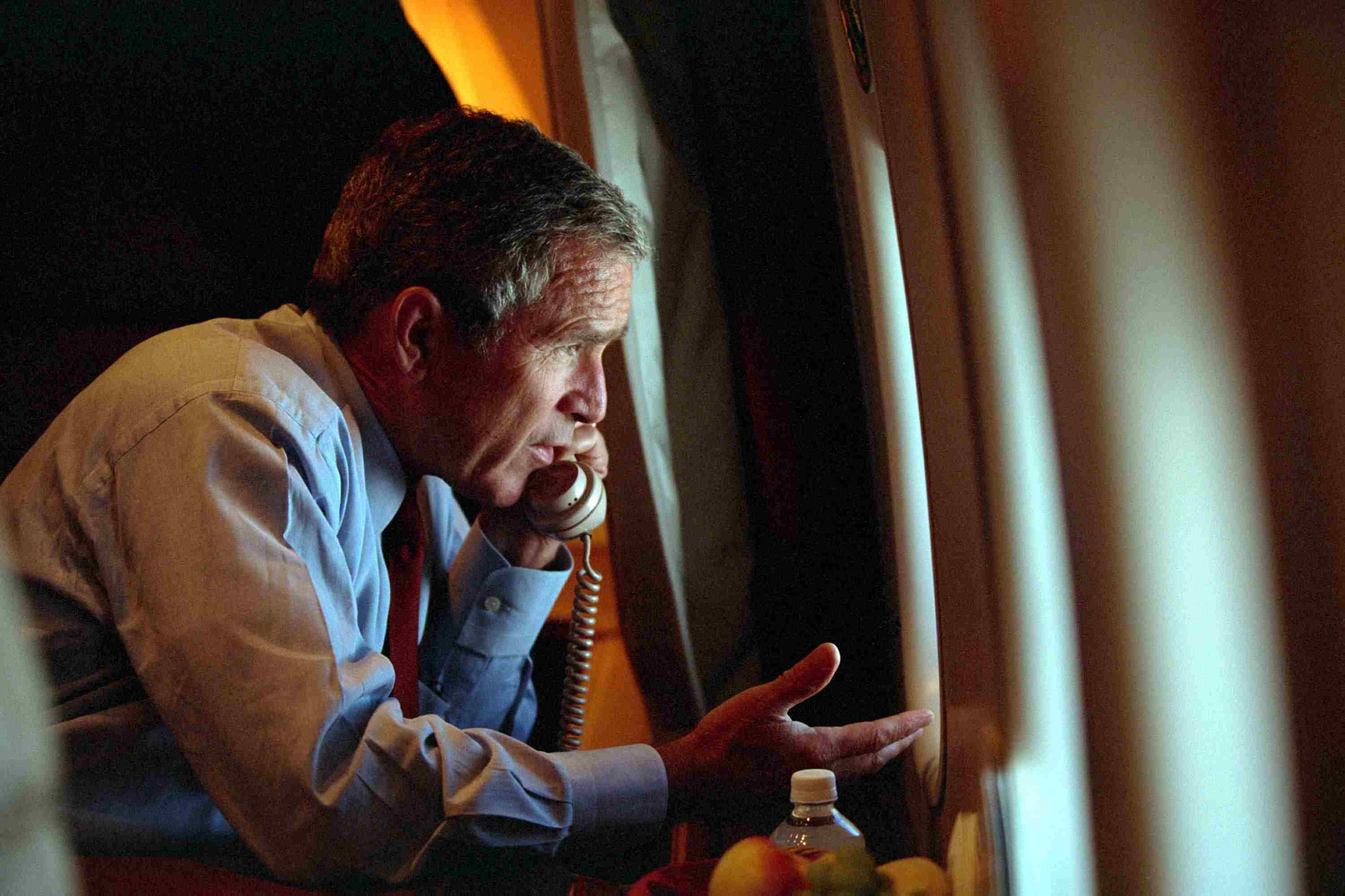 President Bush talking on the phone, dealing with the 2001 recession
