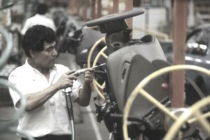 Man working auto assembly line, Mexico City, Mexico