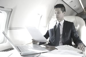 Businessman working on corporate jet