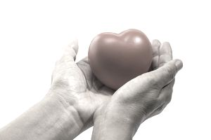Red heart in hand, take care you heart healthy