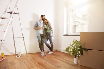 A young couple is moving into their new home.