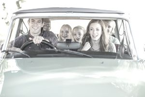 Family in car together taking road trip