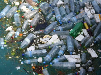 Plastic bottles and polystyrene pollution floating in the water