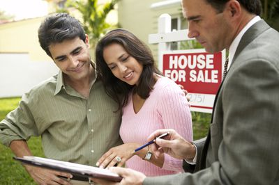 Young home sellers speaking to a realtor about selling their home without equity