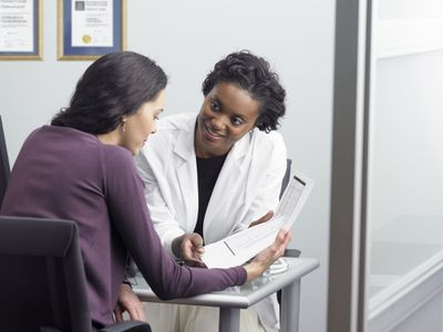 Physician talking with a patient about her HSA