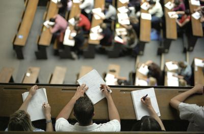 Colorado college students sitting in lecture theatre taking notes