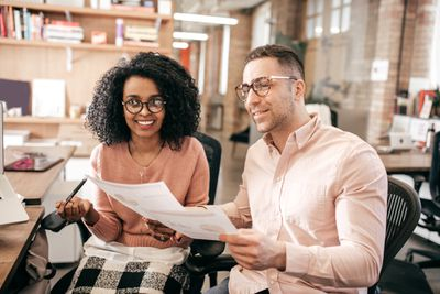 Couple working on taxes together in an office