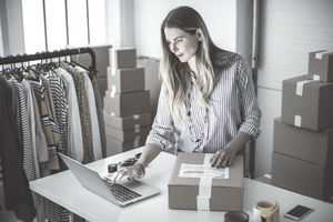 Small business owner ready to ship packages