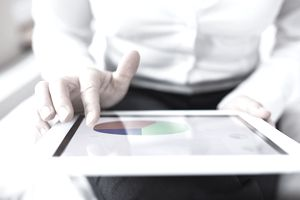Investor reviewing a pie chart showing allocation of bonds in retirement portfolio