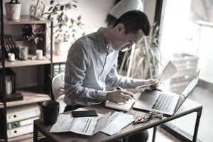 Man reviewing business financial documents