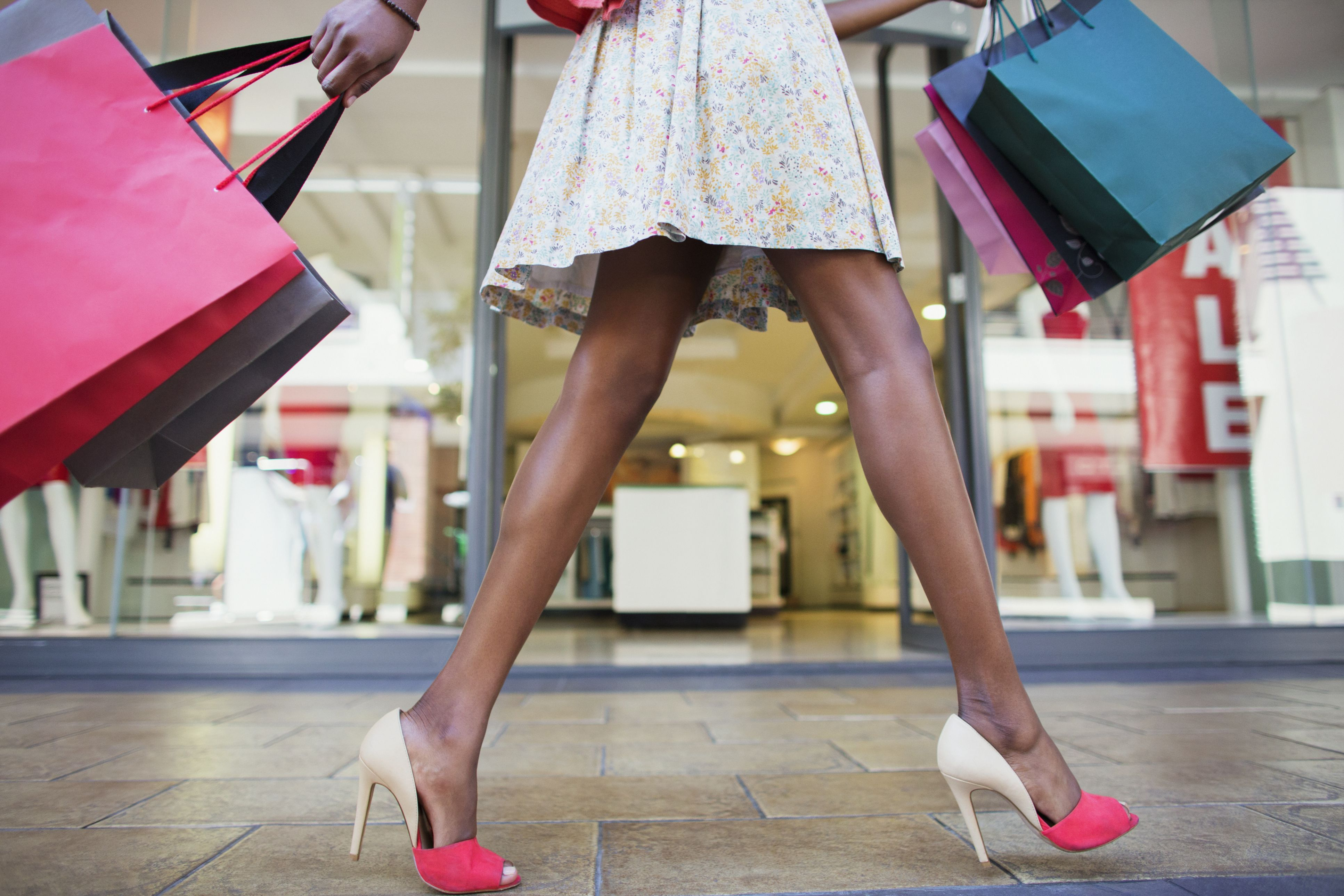 Woman carrying shopping bags in a shopping mall