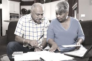 Senior couple reviewing retirement paperwork