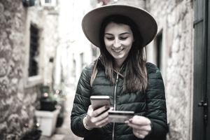 Young woman abroad shopping online with credit card