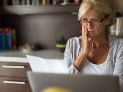 Concerned woman reviewing her credit report