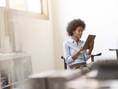 Young professional using digital tablet in bright office