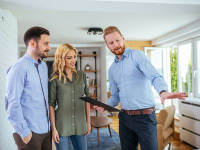 Real estate agent shows home to potential homebuyers