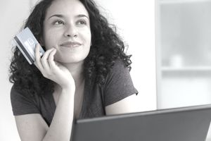 Woman holding an unsecured credit card