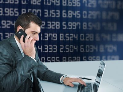 Forex broker on phone and laptop