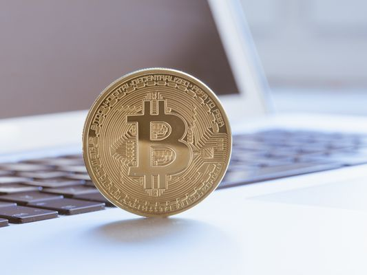 Close-Up Of Bitcoin On Laptop