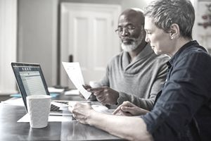 A senior couple working on their finances at home
