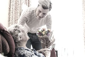 A young man visits his elderly relative
