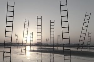 Ladders in water at sunset