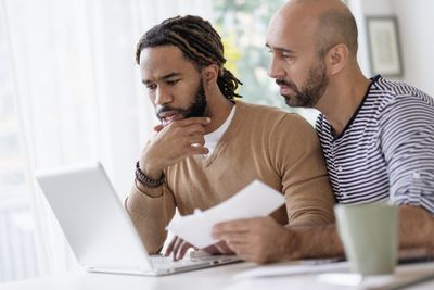 Couple making a decision in front of a laptop