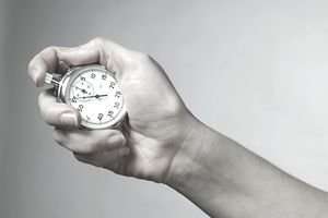 A close-up of a hand with a stop watch