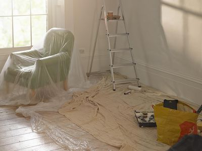 a living room prepped for painting