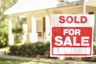 Home for sale with sold sign on lawn