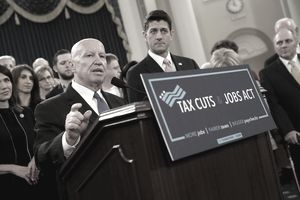 Congressmen at a podium announcing the Tax Cuts and Jobs Act