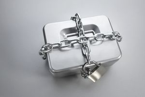 Cash box tied up with chain and padlock, elevated view