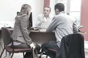 Couple talking to a banker at a bank