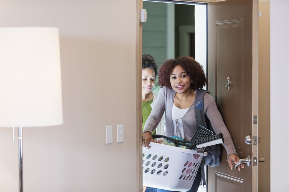 Young woman with mother, moving into apartment