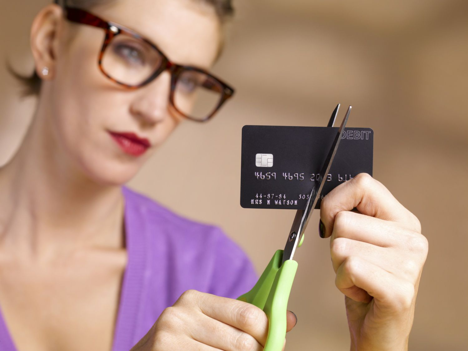 Person cutting up a credit card