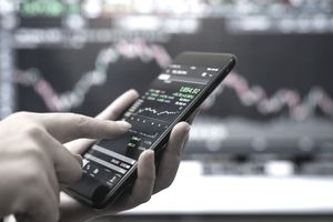Trading on cell phone screen.