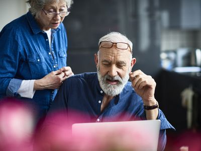 Older couple looking at their retirement income after receiving a cost of living adjustment (COLA)..