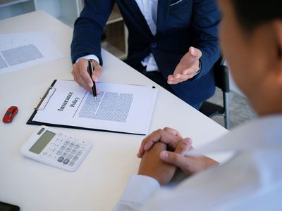 Insurance Agent Explaining an Insurance Policy Contract to a Customer