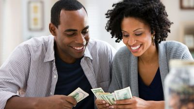 Smiling man and woman counting money