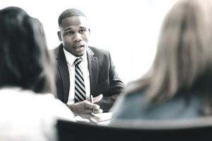Female couple meeting at a desk with an attorney