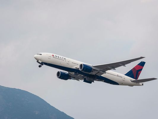 A Boeing 777-232(ER) passenger plane belonging to the Delta Air Lines taking off at Hong Kong International Airport
