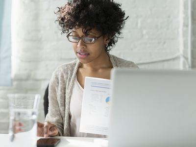 Woman calculating total equity on her investments