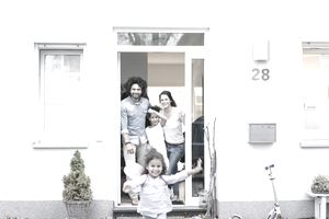 Happy Family with New House