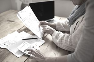 An older woman and younger woman going over an invoice
