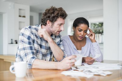 Couple looking at receipts